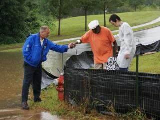 In Raleigh, flooding blocked the entrance to a dialysis clinic, preventing ambulances from getting to patients. Some of the patients had to walk around the water to get to the waiting ambulances.