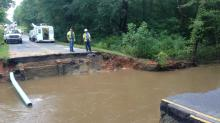 IMAGES: Downpour turns dangerous: Flooding collapses Warrenton road, sweeps away cars
