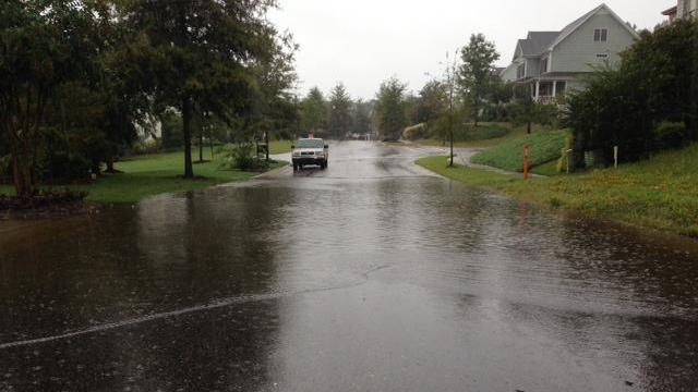 Roads across central North Carolina were soaked Wednesday afternoon, including on Forgotten Pond Road in Wake Forest, as storms moved through the region. (Sloane Heffernan/WRAL)