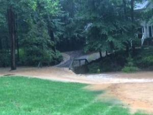Rain flooded roads and yards Wednesday along Saddleridge Road in north Raleigh. (Photo courtesy: Jodi Rucker)