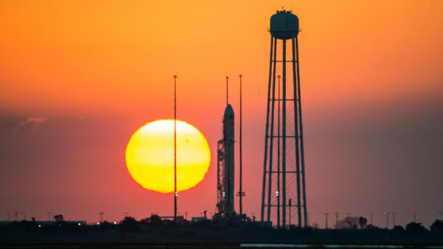 The Orbital Sciences Corporation Antares rocket, with the Cygnus spacecraft onboard, is seen on launch Pad-0A during sunrise, Sunday, Oct. 26, 2014, at NASA's Wallops Flight Facility in Virginia. The Antares will launch with the Cygnus spacecraft filled with over 5,000 pounds of supplies for the International Space Station, including science experiments, experiment hardware, spare parts, and crew provisions. The Orbital-3 mission is Orbital Sciences' third contracted cargo delivery flight to the space station for NASA.  Launch is scheduled for Monday, Oct. 27 at 6:45 p.m. EDT.  Photo Credit: (NASA/Joel Kowsky)