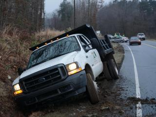 A dump truck ran off the road Wednesday morning and into a ditch.