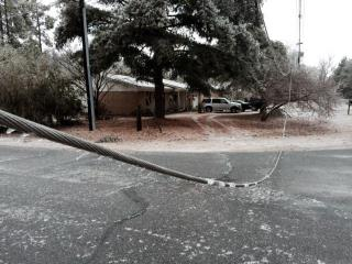 Ice accumulation downed power lines at Stoney Point Road and Mesquite Drive in Hope Mills on Feb. 17, 2015.