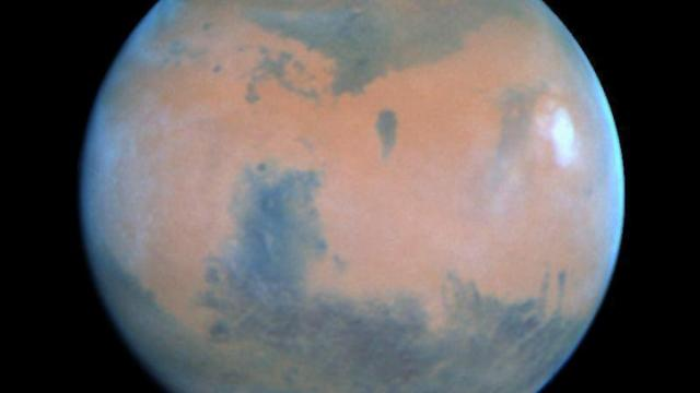 Mars at a distance of 65 million miles as seen by the Hubble Space Telescope in February 1995.
