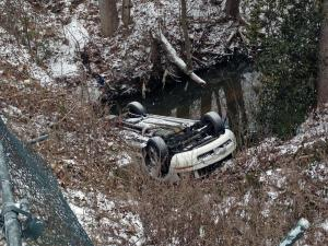 A car ran off Erwin Road in Durham early Tuesday and ended up in a creek. (Photo by Arielle Clay)