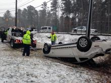 Tow truck pulls car from Durham creek