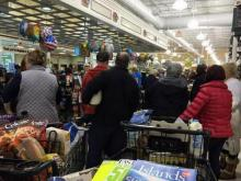 People pack grocery stores ahead of snow storm