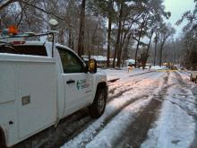 Duke Energy crews work to clear downed tree