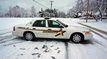 Durham County sheriff's car in the snow