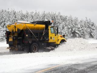 An NCDOT truck plows snow along I-540 near Aviation Parkway in Morrisville on Feb. 26, 2015. (Photo by Lance King)