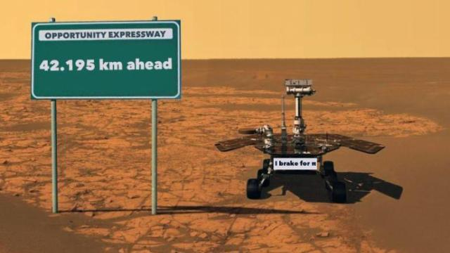 Pi is a big part of what NASA does. How many times will each of Opportunity's 25 cm wheels rotate when it reaches this marathon milestone?