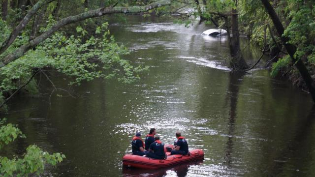 A man hydroplaned on Manchester Road Sunday, slid into the Little River but managed to escape, wet but unharmed.