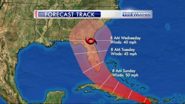 The National Hurricane Center said Friday morning that Tropical Storm Erika's forecast track has shifted westward as the weak storm struggles to stay together in the Caribbean.
