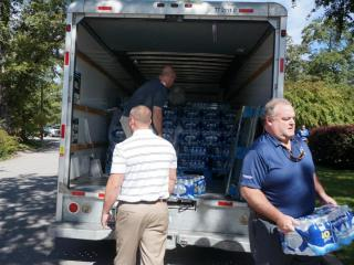 Volunteers were distributing bottled water to South Carolina residents Tuesday, days after floods swamped the state.