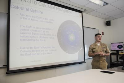 Lt. Daniel Stayton delivers classroom instruction on celestial navigation to midshipmen at the U.S. Naval Academy in Annapolis, MD (Credit: U.S. Navy/Tyler Caswell)