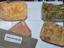 Potatoes au gratin, green beans, and turkey treated with low doses of radiation to make it shelf stable have been on previous Thanksgiving menus aboard ISS as well (Credit: NASA/JSC)