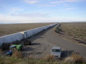 One of the pair of 2.5 mile long LIGO tubes in LIGO interferometer on Hanford Reservation (Credit: CalTech/MIT)