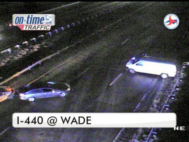 A wreck involving three vehicles shut down I-440 at Wade Avenue early Monday.