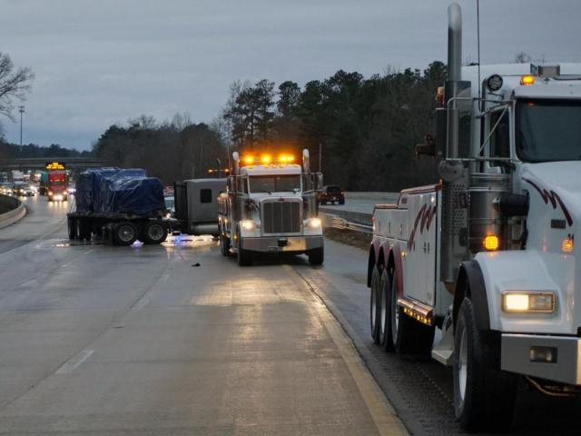 A tractor-trailer and at least three vehicles were involved in a wreck Monday on U.S. Highway 264.