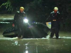 Firefighters came in with boats to rescue about 15 people during flooding Saturday night