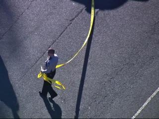Traffic was diverted off U.S. Highway 64 in Apex Friday after a power line fell, ignighting the grass in the media.