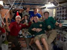 Crew aboard the International Space Station share a Christmas meal together. Credit: NASA/JSC