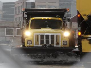 Crews from the North Carolina Department of Transportation set out early Saturday to spread salt and sand and to plow major roads coated with snow and ice from an overnight winter storm.