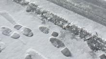 IMAGES: Slick sidewalks bring more slip-and-fall injuries to the ER