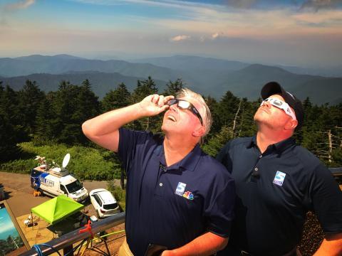 Fishel. Johnson take in solar eclipse