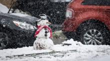 IMAGES: As crews work to clear roads, kids enjoy blanket of snow in Raleigh