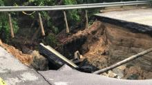 IMAGE: Residents said Raleigh road was damaged for a year before 25-foot sinkhole opened