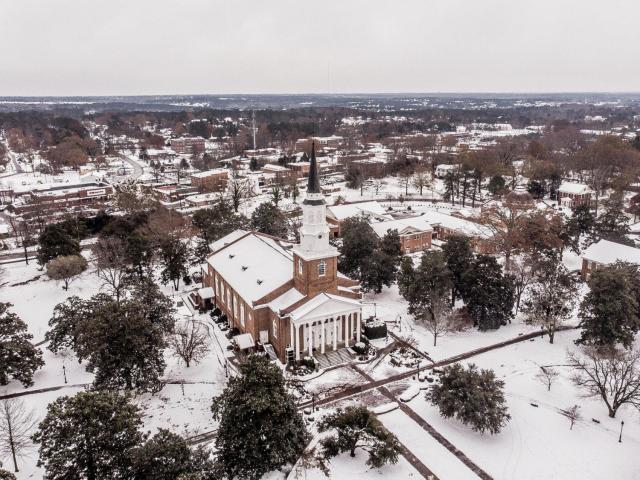 Still snow on the ground in Wake Forest with a few flurries. Got the drone up. South Eastern Baptist Seminary/Old Wake Forest College Campus - Wake Forest, NC.