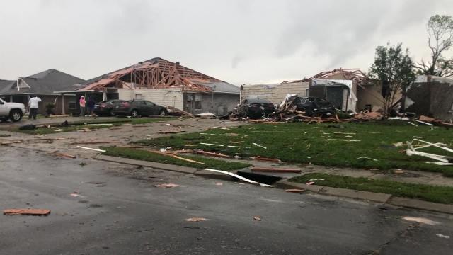 Storms that spawned tornadoes and killed 18 people in the South are heading north