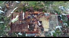 IMAGES: Storms and tornadoes leave behind battered homes and at least 32 victims in the South before lashing East Coast
