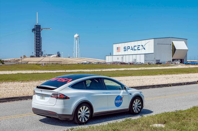 """SpaceX's Tesla Model X astronaut transfer vehicle is emblazoned with both NASA's most recent """"meatball"""" and classic """"worm"""" insignia.<br/>Reporter: Tony Rice"""
