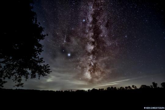 A satellite passes near the milky way (Photo: Ken Christison)