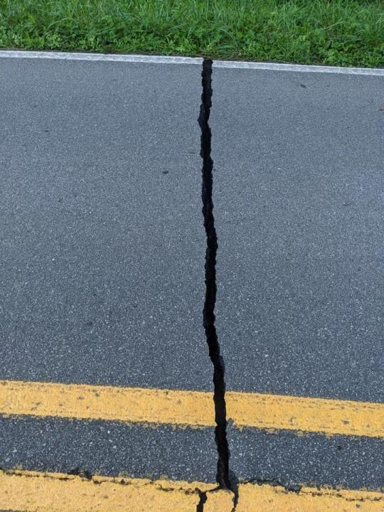 Cracked Road in Sparta, NC from the earthquake August 9. Photo per Terry Greene  posted by the North Carolina's Weather Authority
