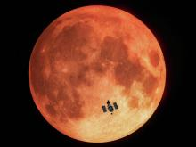 The full moon and the Hubble Space Telescope