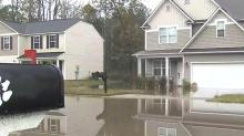 IMAGE: In Fayetteville neighborhood, frustration rises along with floodwaters