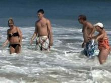 Swimmers test waves before hurricane