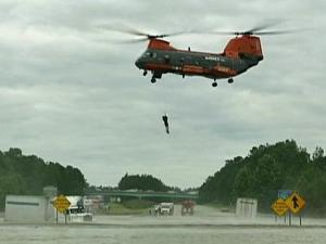 "Marines in the ""Pedro"" unit drop from the sky to rescue those trapped at sea or by flooding."