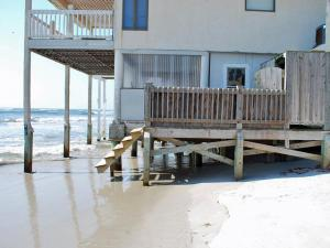 The surf ripped the front stairs off a vacation home in North Topsail Island on Wednesday, Sept. 1, 2010, as Hurricane Earl approached. (Photo courtesy of Brian Tusler)