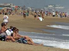 People return to the beach in Nags Head, N.C., Saturday, Sept. 4, 2010 after Hurricane Earl dumped heavy rain and wind on North Carolina's Outer Banks.