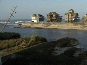 Damage to N.C. 12 cut off land access to Hatteras and Ocracoke islands, stranding at least 2,500 people and bringing a sudden end to the summer tourist season upon which the region's economy depends heavily.