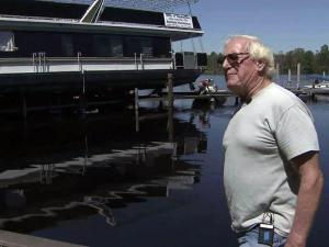 Owner A.G. Swanner said he's amazed that his cruise ship The Belle of Washington landed perfectly atop a neighbor's dock.