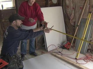 Volunteer Mike Collins helps to rebuild George Midgette's Pamlico County home, which was damaged by flooding from Hurricane Irene on Aug. 27, 2011.