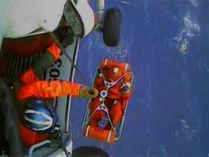 A screen grab of U.S. Coast Guard video of the rescue of the crew from the HMS Bounty. (Courtesy of U.S. Coast Guard)