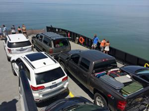 Ferry service resumed to Ocracoke Island Sunday, two days after Hurricane Arthur's 100-mph passing.