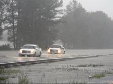 Raw: Cars drive through floodwaters on I-95