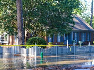 This house on Westview Park Dr. in Rocky Mount was surrounded by water after a creek flooded on Sunday, Oct. 9, 2016. The creek was flooded by rain from Hurricane Matthew. (Photo By: Nick Stevens/WRAL)